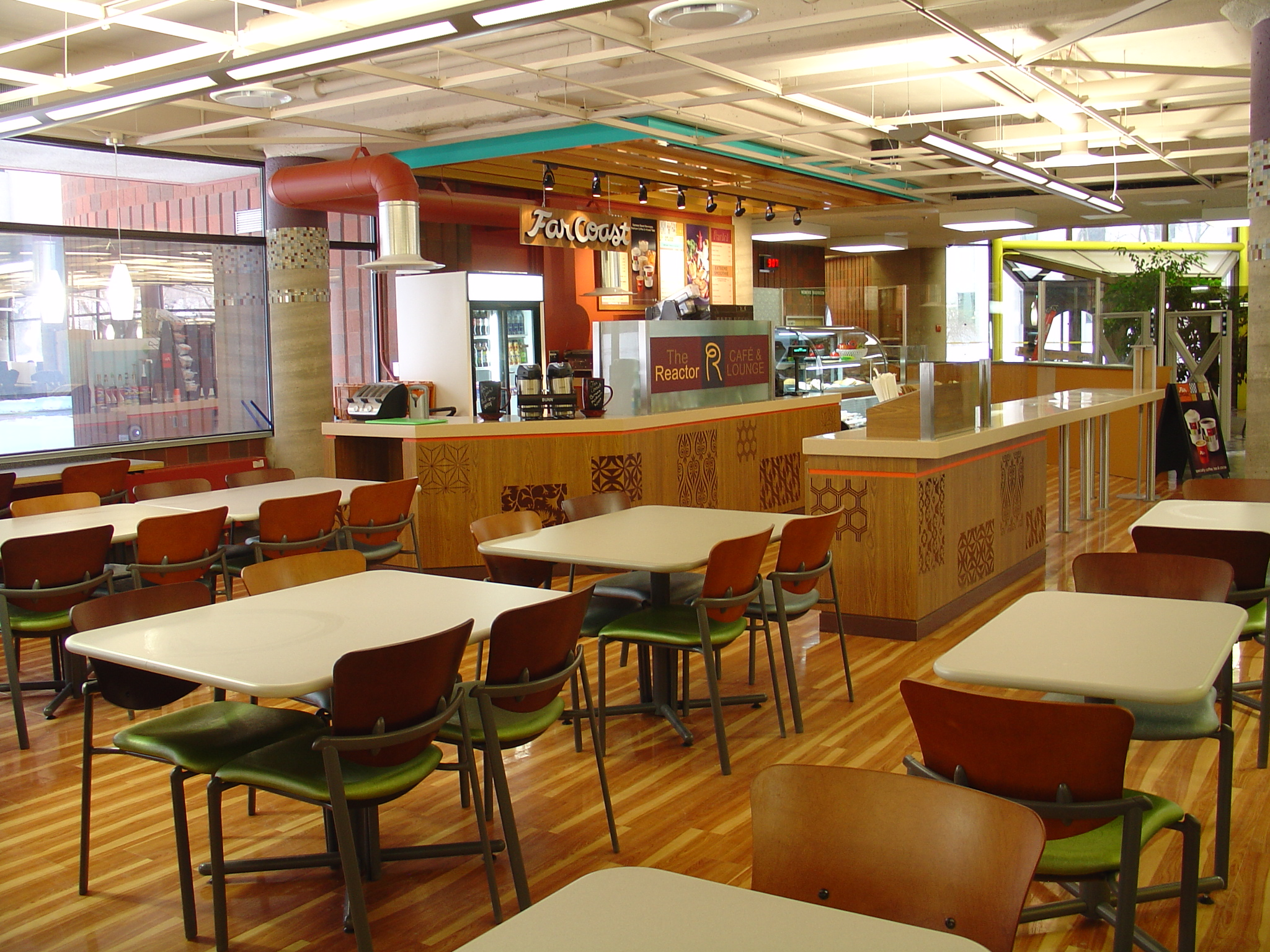 View of table and seating with cafe in the background