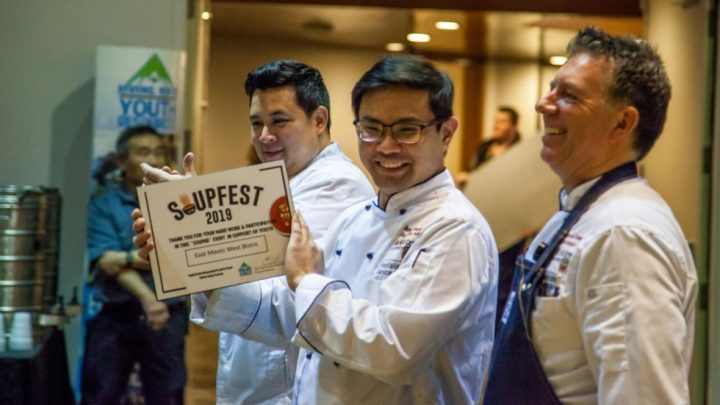 3 chefs, one is holding up an award for most creative soup