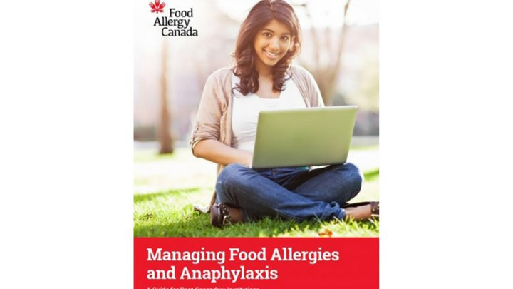 Front cover of Food Allergy Canada brochure. Female student sitting with laptop