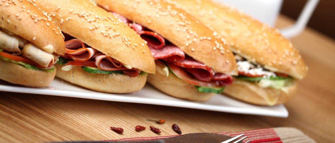 Close up view of submarine sandwiches on a serving plate