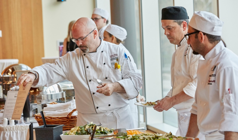 candid photo of Chefs hosting a catering event