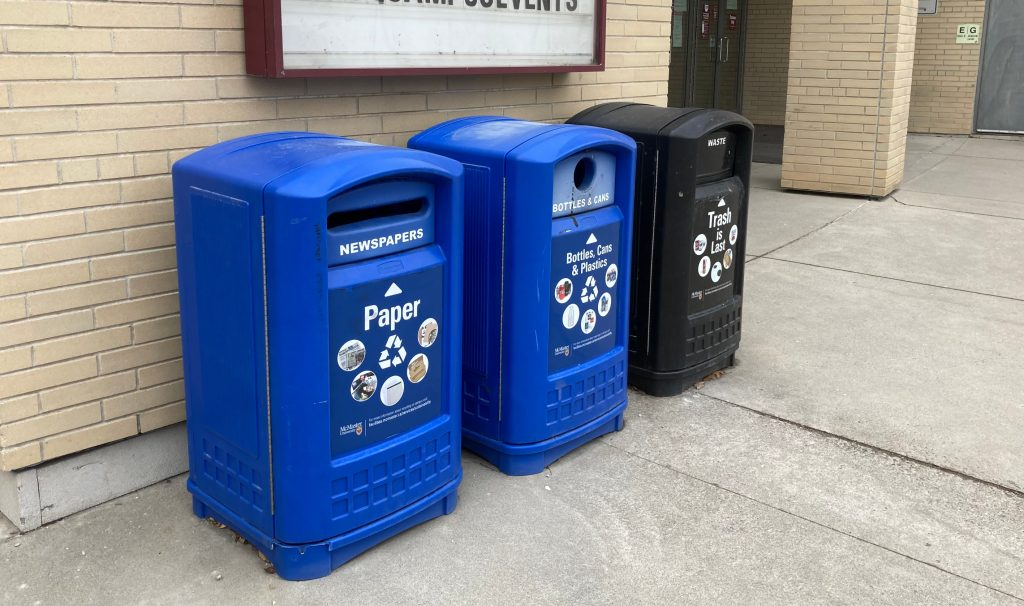 Recycling and garbage bins with detailed labels